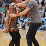 """Judge Mrs. Rasmussen hugs junior Jacob DeSett after he chose to join her team during the Pep Club's """"The Voice"""" competition. Photo by Haley Bell"""