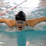 Freshman Hannah Phillips competes in the 100 yard butterfly. Photo by Haley Bell