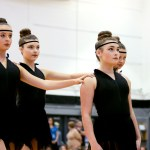 """Varsity Lancer Dancers, Savanna Worthington, Isabelle Cunningham, Katie Faught, and Catherin Watkins pose to start their lyrical dance """"Rise Up"""". Photo by Maddie Smiley"""