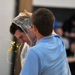 Senior Spencer Mustoe smashed an egg on senior Joey Wentz's head during the egg smashing competition. Photo by Carson Holtgraves