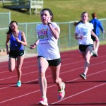 Sophomore Katie Macadam practices her sprints down the track. Photo by Katie Lamar