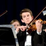 Junior Joey Gasperi looks up to the conductor during the performance. Photo by Ellie Thoma
