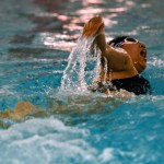Freshman Shehara Hernandez-Robinson takes a breath during her freestyle lap. Photo by Diana Percy