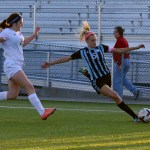 Senior Elisabeth Shook prepares to kick the ball towards the goal. Photo by Diana Percy