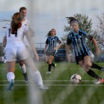 Junior Josie Clough runs up to the ball to take a shot on goal. Photo by Diana Percy