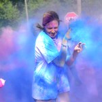 Senior Hannah Eldred runs through the last color station to finish the race. Photo by Ellie Thoma