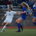 Junior Josie Clough kicks the ball to her teammate waiting by the goal. Photo by Morgan Browning