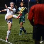 Junior Josie Clough kicks the ball to her teammate during the second half of the game. Photo by Morgan Browning