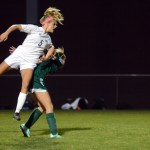 Senior Elizabeth Shook makes the first goal of the game by heading it in. Photo by Morgan Browning