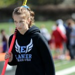 Sophomore Julia Kapros waits for her chance to pole vault.  Photo by Tess Iler