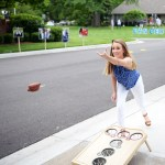 Junior Libby LeGard throws bean bag while playing cornhole at Hayes Hendricks, Luke Ehly and George Colby's graduation party. Photo by Porter Carroll