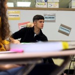 "The walls of Mrs. Fry's room are covered in literary devices, things that are especially helpful during this unit. In this photo, Drake Woods waits to respond to Mrs. Fry's ""question of the day"". Photo by Leah O'Connor"
