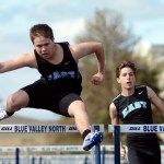 Sophomore Frank Shudy hurdles a hurdle during the 110m hurdles.  Photo by Tess Iler