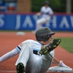 Junior Trevor Thompson slides into third base after a single was hit into right field. Photo by Joseph Cline