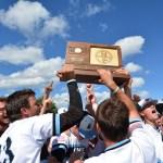 Upon receiving their trophy, the team celebrates joyfully. Photo by Joseph Cline