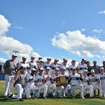 The Boys' baseball team poses after the game for a team picture. Photo by Joseph Cline