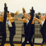 Senior Gretchen Crum and Juniors Emma Renwick and Savanna Worthington perform their kick line. Photo by Caroline Mills
