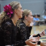 """Sophomores Olivia Caponecchi and Piper Noblit cheer on the Varsity Lancer Dancers. JV Captain Maggie Mulligan says """"I think JV has a really great bond so far...I can definitely see us getting closer with each practice."""" Photo by Caroline Mills"""