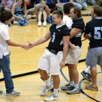 Senior and varsity soccer player Will Krebs shakes hands with junior football player Milton Braasch after his team's tug-of-war defeat. Photo by Diana Percy