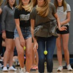 Seniors Gretchen Cooper and Libby Wilson hop across the gym during a new pep assembly activity. Photo by Carson Holtgraves