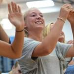 Senior Ellie Mitchell claps for senior classmate Sean Overton. Photo by Katherine Odell