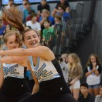 Sophomore Megan Walstrom whips while performing team dance with the varsity lancer dancers. Photo by Ellen Swanson