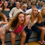 Seniors Ellie Booton, Josie Clough, Libby Legard, and Sophie Thiede wait for the seniors turn to vote for the dance competition. Photo by Annie Lomshek