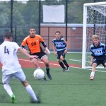 Junior Varsity soccer goalie Brandon McGaugh guards the goal along with his teammates to keep varsity from scoring at the Blue and Black soccer scrimmage. Photo by Katherine Odell