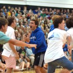 Junior Collyn Lowry celebrates with his soccer team their victory in tug-of-war against the football team. Photo by Izzy Zanone