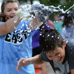 Freshman Megan Devolder splashes freshman Noah Nilsson-Paul with soapy water. Photo by Ellen Swanson