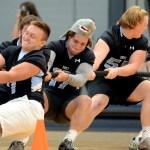 Varsity football teammates Milton Braasch, Simon Bradley, Charlie Kephart, and Eli McDonald play tug-of-war against members of the varsity soccer team. Photo by Maddie Smiley