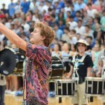 """Senior Brayten Bowers leads the crowd in a new chant.  """"It was awesome having everyone come up to me afterwards saying how hyped they got even though it was just an assembly,"""" said Bowers. Photo by Sophie Storbeck"""