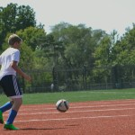 Getting ready to make a pass to his partner. The Soccer player is eager to be placed on a team (D-team, C-team, JV or Varsity), seeing that it was the last day of tryouts. Photo by Morgan Plunkett