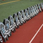 The senior football players' yard signs are lined up next to the field. Photo by Caroline Mills