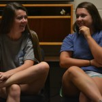 Juniors Katie Hise and Grace Chisholm laugh along with eachother on the student council retreat, during a ball passing game. Photo by Morgan Plunkett