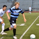 Senior Stanley Morantz runs to get the ball in hopes of getting down the field to score a goal. Photo by Katherine Odell