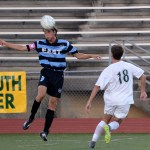 Senior Clayton Phillips jumps up for a header. Photo by Kaitlyn Stratman