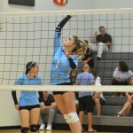 Sophomore Claire Severen spikes the ball over the net to the opposing side. Photo by Katherine Odell