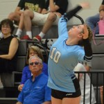 Sophomore Maggie Scott serves the ball to the opposing team. Photo by Katherine Odell
