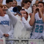Seniors William Larson, Tommy Kerr, Taylor Nordak, Connor Rieg, and Will Krebs yell to the Rockhurst student section. Photo by Carson Holtgraves