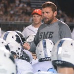 Coach Dustin Delaney gives the Varsity football team a pep talk after losing to Rockhurst. Photo by Carson Holtgraves