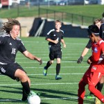 Sophomore Austin Brende uses his soccer skills to beat the oncoming opposing offender. Photo by Katherine Odell