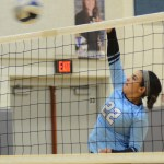 Sophomore Christina Brogden spikes the ball over the net. Photo by Ellen Swanson