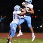 Junior Justin Finnigan lifts junior Milton Braasch into the air after Braasch's touchdown. Photo by Haley Bell