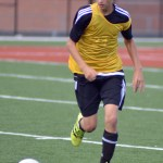 Freshman Hayden Talge rushes to be in possession of the ball. Photo by Izzy Zanone