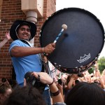 "Junior Siddharth Choudhury plays his drum during the ""East"" chant led by Senior Brayten Bowers. Photo by Morgan Browning"
