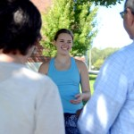 Junior Isabel Epstein makes a sale and talks about the goal of the bake sale to two customers. Photo by Maddie Smiley