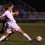 Senior Oliver Bihuniak tries to regain control of the ball. Photo by Sophie Storbeck