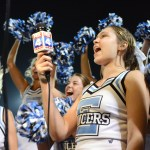 Senior Rachel Rodgers cheers with the rest of the cheerleaders after helping film an ad for Hyvee. Photo by Ellie Thoma