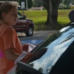 Sophomore Hanna Goettsch dries off the car of one of the donaters for the girl's swim carwash. Photo by Morgan Plunkett